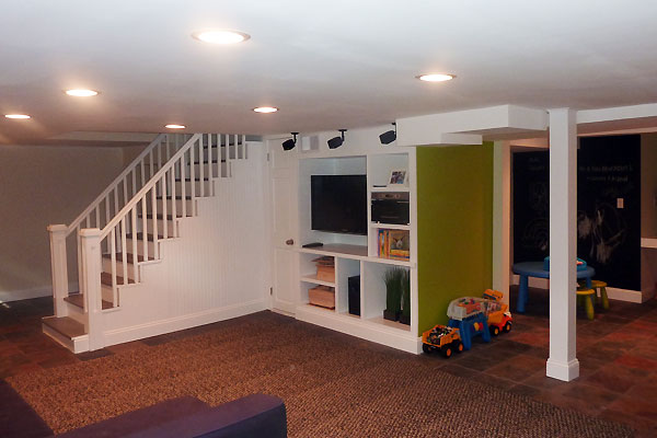 Modern Finished Basement With Built In And Slate Tiles