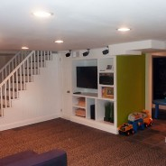Modern Finished Basement with Built-in and Slate Tiles