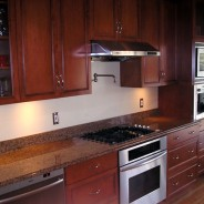 Colonial Kitchen with Cherry Cabinets and Pot Filler Faucet
