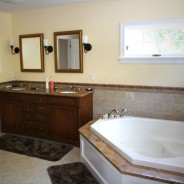 Luxury Master Bathroom with Frameless Shower and Steam Shower