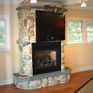 Luxury Custom Fireplace and Coffered Ceiling
